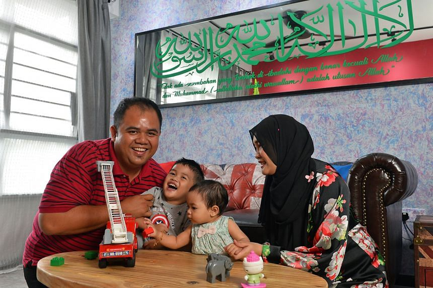 Mr Fahren and his wife Nur'ain Osman and their two children moved into their Punggol flat at the end of December last year. PHOTO: CHONG JUN LIANG
