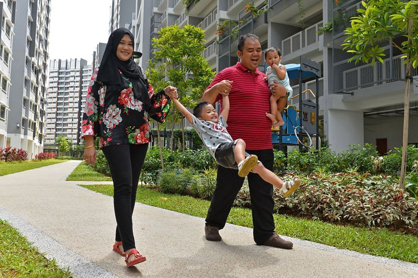 Mr Fahren and Ms Nur'ain strolls with their children in the estate. PHOTO: CHONG JUN LIANG