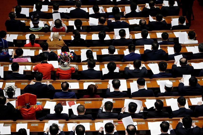 Delegates at the fourth plenary session of the National People's Congress (NPC) at the Great Hall of the People in Beijing on March 13, 2018.