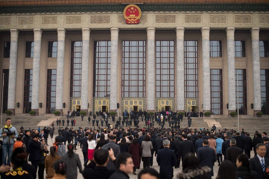 Delegates arrive for the National People's Congress (NPC) at the the Great Hall of the People in Beijing, on March 11, 2018.