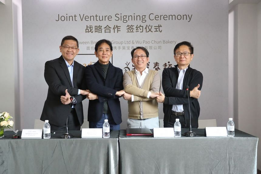 (From far left) BreadTalk Group chief executive Henry Chu and chairman George Quek, with Wu Pao Chun Food founder Wu Pao Chun and executive vice-president David Chiu at the joint venture signing ceremony.