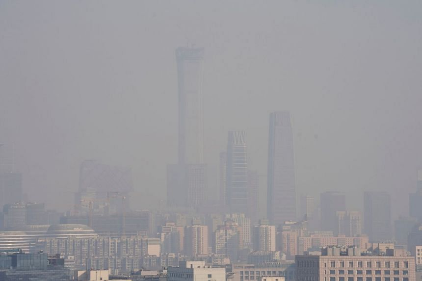 The Beijing city skyline is seen amid smog, ahead of Chinese Lunar New Year, on Feb 13, 2018.