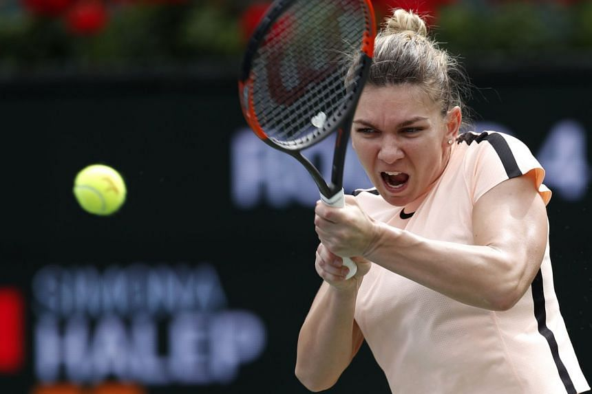 Halep in action against Wang Qiang of China.