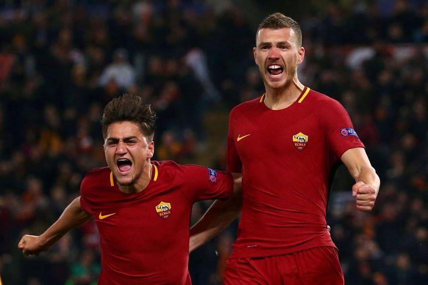 Roma's Edin Dzeko celebrates with Cengiz Under after scoring.