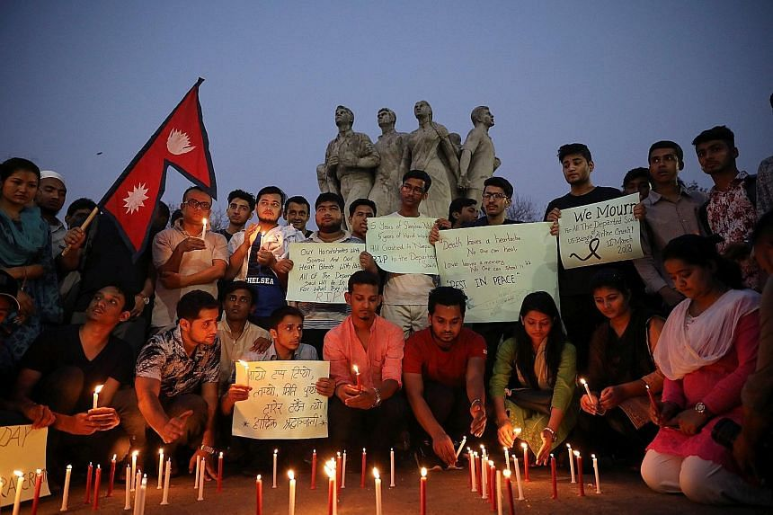 Nepali students of the University of Dhaka at a memorial for the victims of the fatal air crash.
