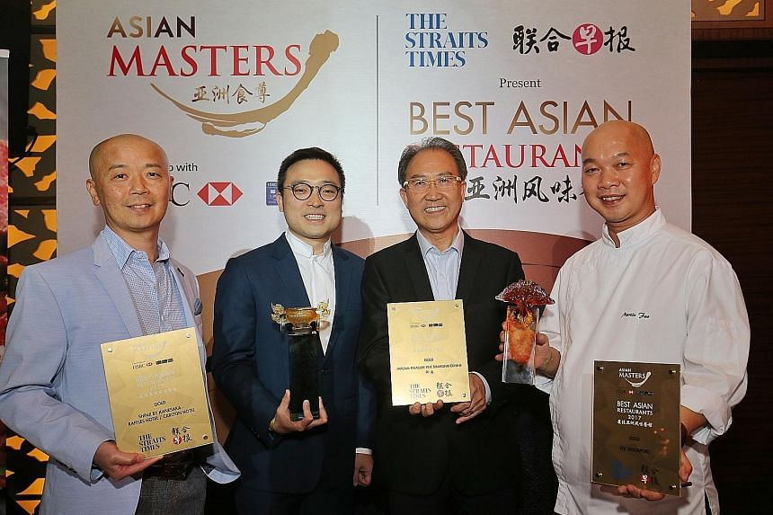 Receiving Best Asian Restaurants Awards last year were (from left) Shinji by Kanesaka's master chef Koichiro Oshino; Imperial Treasure Restaurant Group's founder Alfred Leung's son Kenny, and younger brother Vincent (collecting the award on his behal