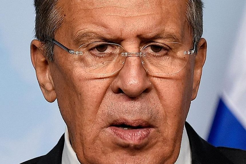 Investigators at work as part of the ongoing probe into the poisoning of a former Russian double agent and his daughter last week. Russian Foreign Minister Sergei Lavrov (above) has denied Moscow's involvement in the attack.