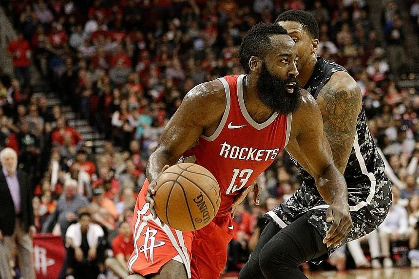 Houston's James Harden driving past the San Antonio Spurs' Rudy Gay during the Rockets' 109-93 home win at the Toyota Centre. Their loss left San Antonio in danger of missing the play-offs after they fell out of the top eight in the Western Conferenc