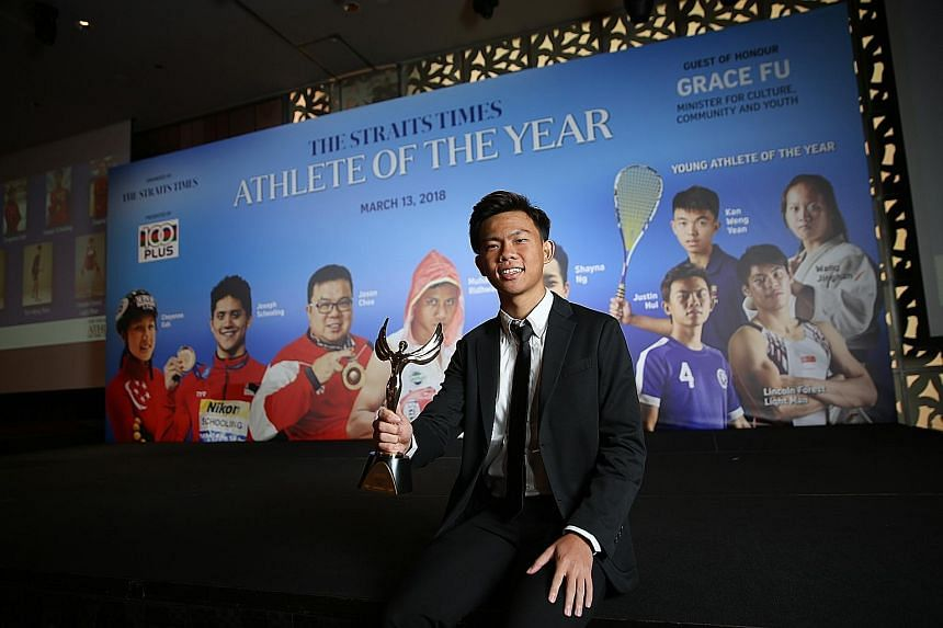 From top: The ST Young Athlete of the Year Justin Hui with his trophy. Wang Jinghan (centre), formerly from Nanyang Girls' High School, nominated for her judo exploits, having fun at the photo booth with friends. Minister for Culture, Community and Y