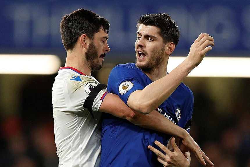 Crystal Palace's James Tomkins clashing with Chelsea's Alvaro Morata in their Premier League match last Saturday. Starting at No. 9 could just be the spark for the Spaniard after a lean spell since Christmas.