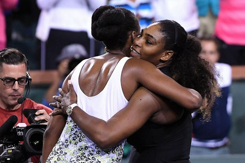 Serena Williams sharing a hug with sister Venus after their third-round Indian Wells clash. The younger Williams lost 3-6, 4-6 in her first official tournament since taking a year-long break to give birth to her daughter.