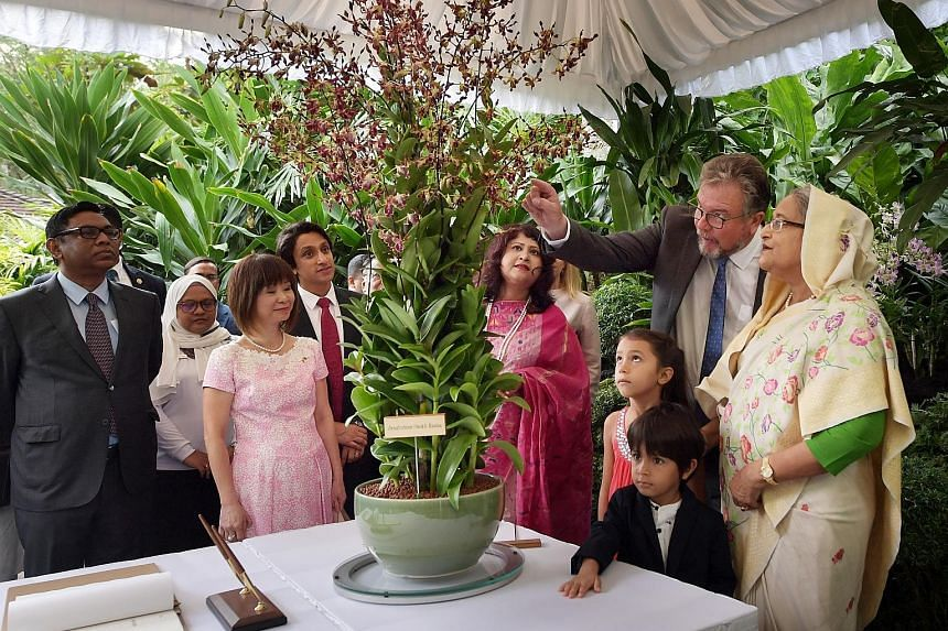 Bangladeshi Prime Minister Sheikh Hasina (right) and her family members being shown the Dendrobium sheikh hasina by Singapore Botanic Gardens group director Nigel Taylor. With them are Bangladesh's State Minister for Power, Energy and Mineral Resourc