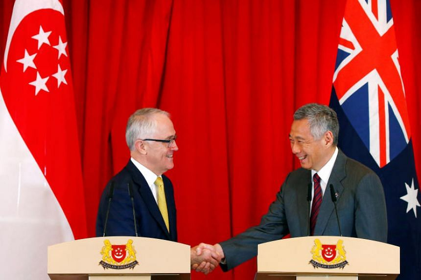 Australia's Prime Minister Malcolm Turnbull and Prime Minister Lee Hsien Loong shake hands at the Istana on June 2, 2017.