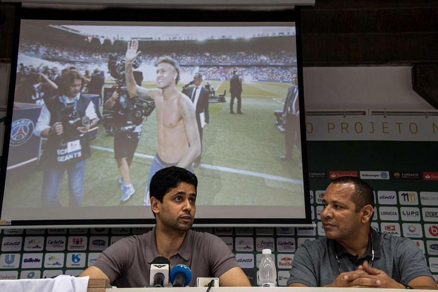 PSG president Nasser Al-Khelaifi (left) and Neymar Santos deliver a press conference in Brazil on March 13, 2018.