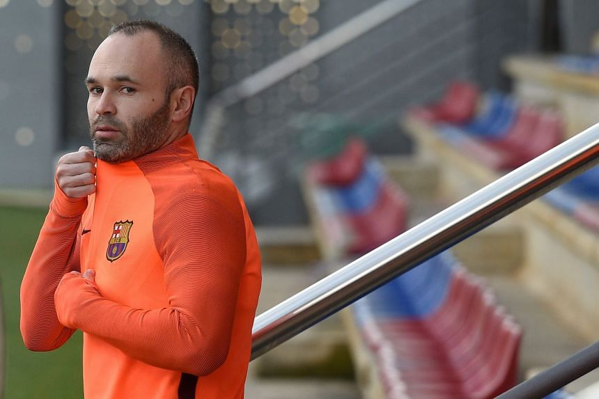 Barcelona's midfielder Andres Iniesta arrives for a training session.