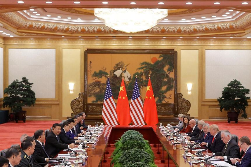 A file phot of President Donald Trump and China's President Xi Jinping holding bilateral meetings at the Great Hall of the People in Beijing, China, on Nov 9, 2017.