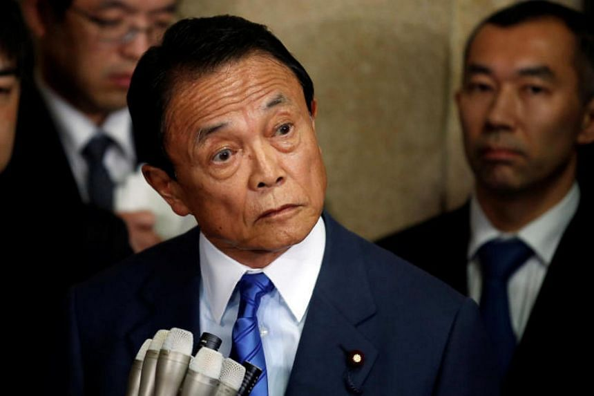 Japan's Finance Minister Taro Aso speaks to reporters in Tokyo, Japan, on March 12, 2018.