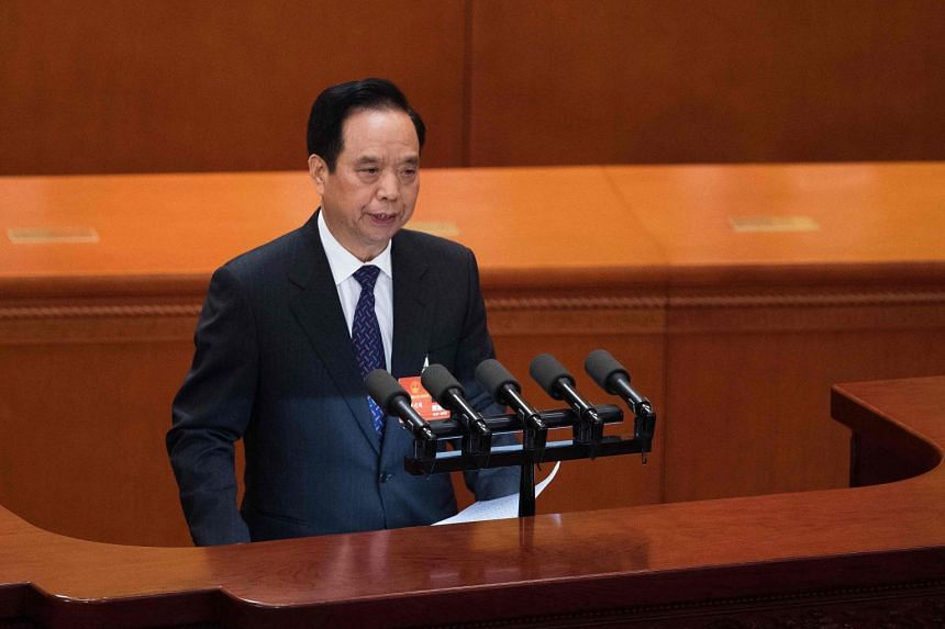 Vice-chairman of the National People's Congress Li Jianguo speaks during the the fourth plenary session of the National People's Congress at the Great Hall of the People in Beijing on March 13, 2018.