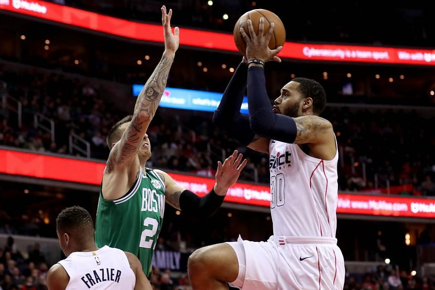 Mike Scott of the Washington Wizards puts up a shot over Daniel Theis of the Boston Celtics at Capital One Arena in Washington, DC on Feb 8, 2018.