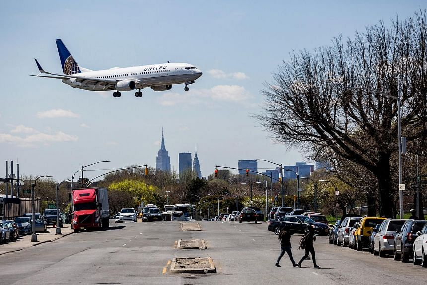 A United Airlines plane prepares for landing at LaGuardia Airport in New York, on April 18, 2017.