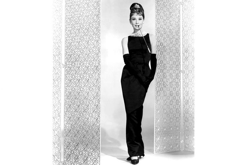 French fashion designer Hubert de Givenchy in a 2016 file photo. Audrey Hepburn in Givenchy on the set of 1961 film Breakfast At Tiffany's.
