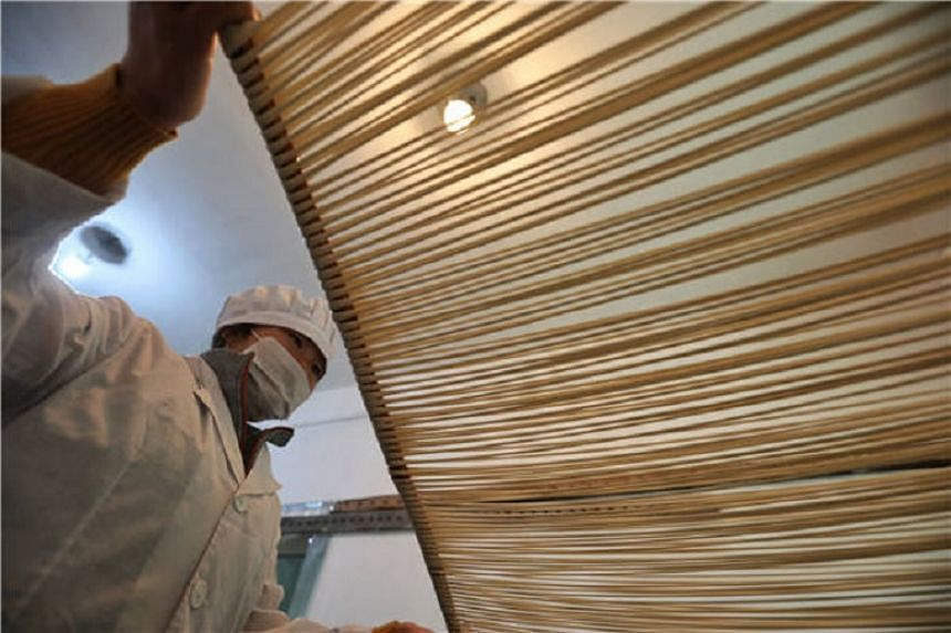 """Among the 72 steps to make Suiyang noodles, """"pulling"""" is tough physical work."""