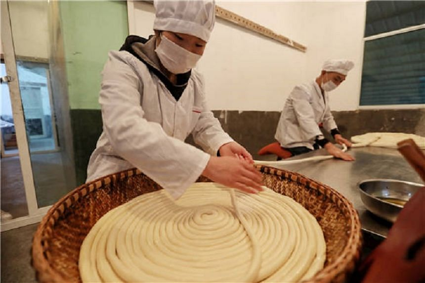 "Among the 72 steps to make Suiyang noodles, ""pulling"" is tough physical work."