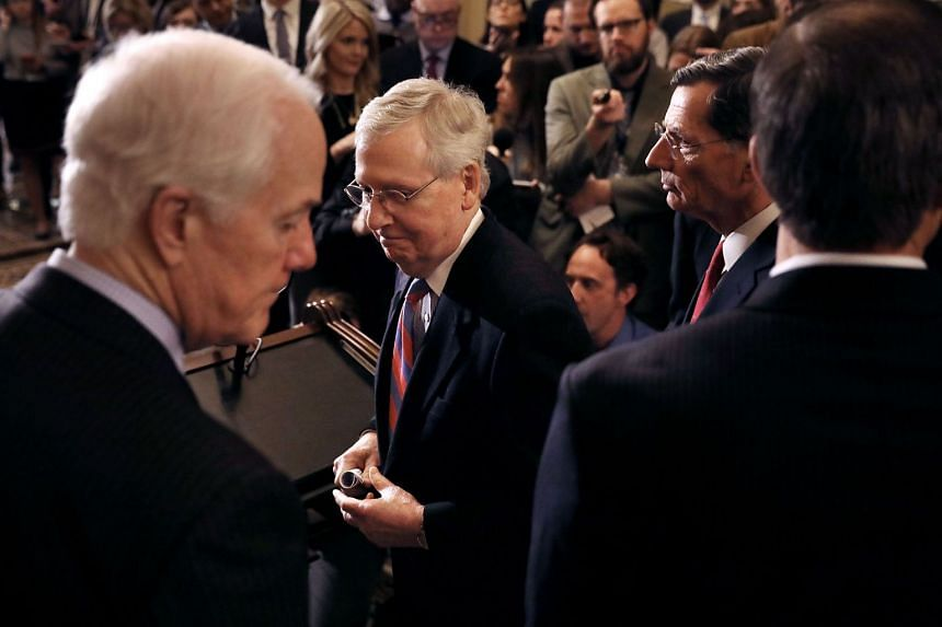 McConnell (centre) and Majority Whip John Cornyn (left) leave a news conference at the US Capitol, March 13, 2018.