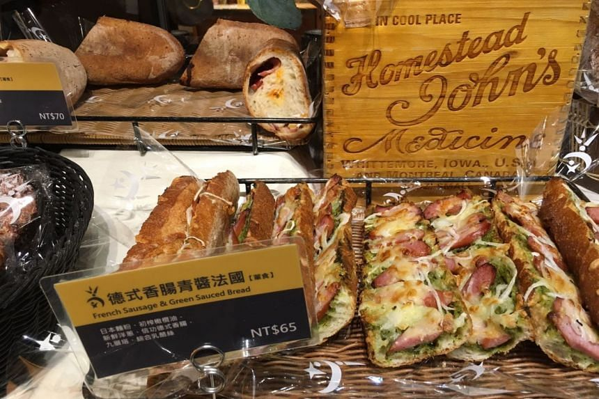 Sausage pizza slices on display at Wu Pao Chun bakery in Taipei. PHOTO: ST READER