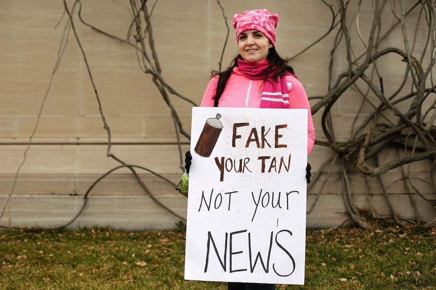 "Protesters displaying a sign referring to ""Fake News"" in Washington, during the Women's March on Jan 21, 2017."