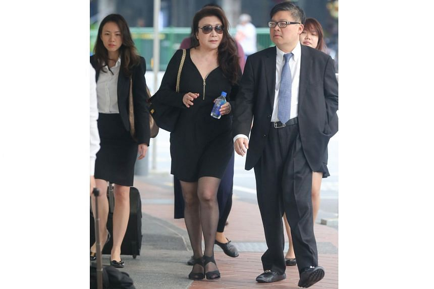 Ferrari driver Shi Ka Yee (centre) was offered bail of $10,000 and will be back in court on April 4.