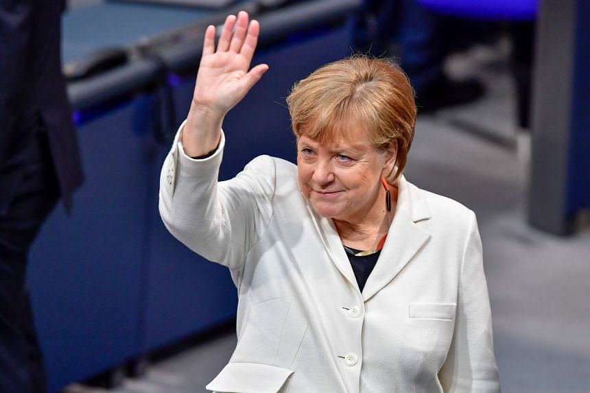 German Chancellor Angela Merkel arrives to attend the session for the election of the German Chancellor at the Bundestag (lower house of parliament), on March 14, 2018 in Berlin.