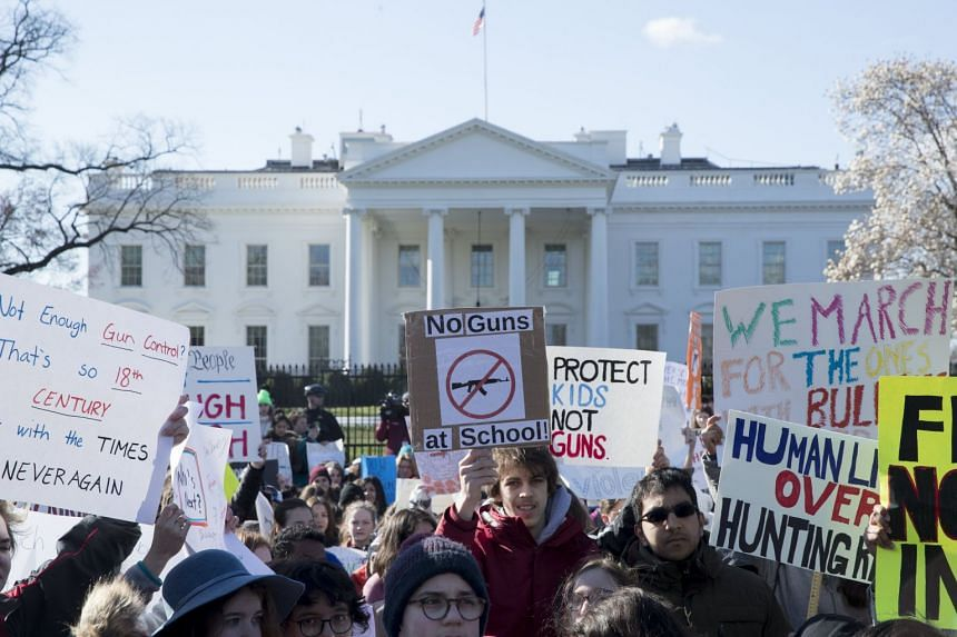 Young people participate in the national school walkout over gun violence at a rally on Pennsylvania Avenue outside the White House in Washington, DC.