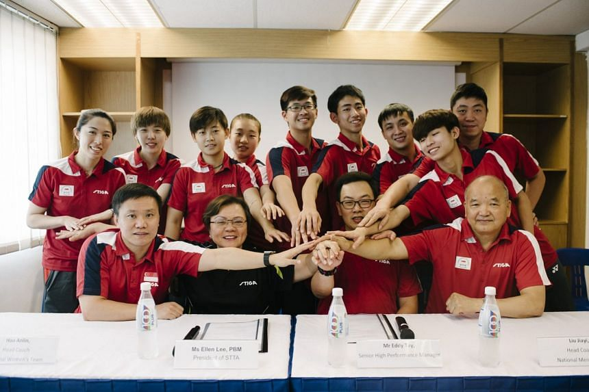 Members of the men's and women's national table tennis team pose for a photo with their coaches and STTA President Ellen Lee (front row, second from left) and Senior High Performance Manager Eddy Tay (centre).