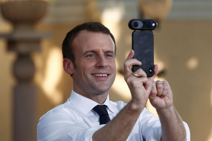 Macron takes a 360-degree photo after meeting students during a trip to India in March 2017.
