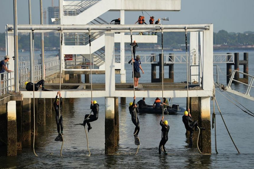 """Trainees do a rope climb as part of the Sea Circuit, one of the five """"vetoes"""" they have to pass in order to become a combat diver during the five-month Combat Diver Course."""