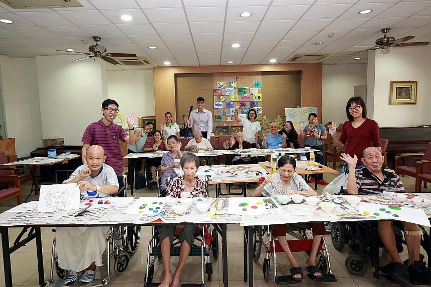 Mr Lim Yi Wei (front row, far left), 45, Madam Ang Keng Nai (front row, second from left), 77, Mr Khang Tock Kwang (front row, far right), 88, and Mr Chee Tie Sing (back row, third from right, wearing blue top), 80, from Orange Valley Nursing Home (