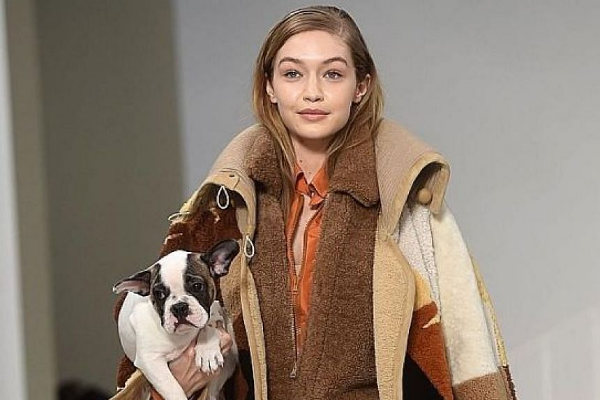 Model Gigi Hadid presenting a creation by Tod's at the Fall/Winter 2018/2019 collection fashion show in Milan last month.