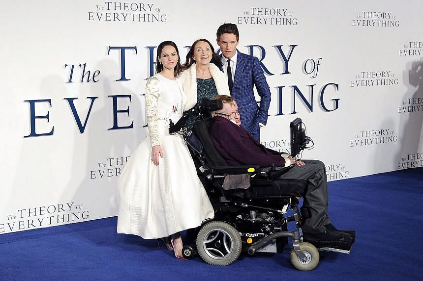 Left: Dr Stephen Hawking with (from left) actress Felicity Jones, his former wife Jane Wilde Hawking, and actor Eddie Redmayne at the UK premiere of The Theory Of Everything in 2014. Top: Dr Hawking and his new bride Elaine Mason in 1995. Above: Then
