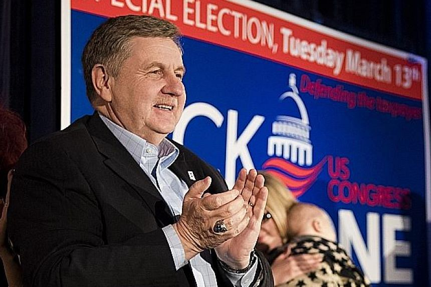 Democrat Conor Lamb (left) was leading his Republican opponent Rick Saccone by a fraction of a percentage point in the contest for a Pennsylvania district late yesterday.