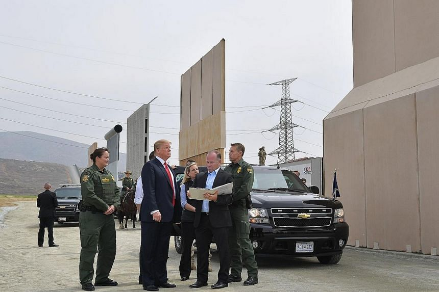 President Donald Trump inspecting border wall prototypes in San Diego on Tuesday. He insisted law enforcement personnel should be able to see through the structure to monitor criminal cartels on the Mexican side.
