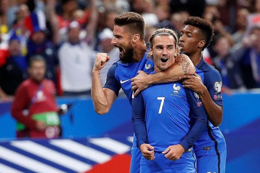 Antoine Griezmann (centre) celebrates scoring France's first goal against the Netherlands on Aug 31 last year with Olivier Giroud (left) and Kingsley Coman. Former France and Bayern Munich left-back Bixente Lizarazu backs Les Bleus to at least reach