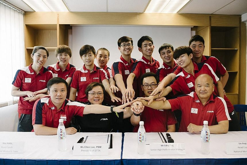 The men's and women's table tennis teams that will represent Singapore at the Commonwealth Games next month, together with their coaches and STTA president Ellen Lee.