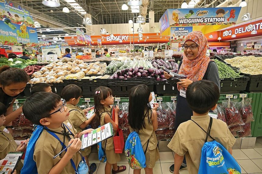 Kindle Garden kindergarten children being taken on an educational tour of Giant supermarket in Tampines by a facilitator from creative educator My Messy Box as part of Giant's Goodness Gang campaign, which aims to get children to eat more healthily.
