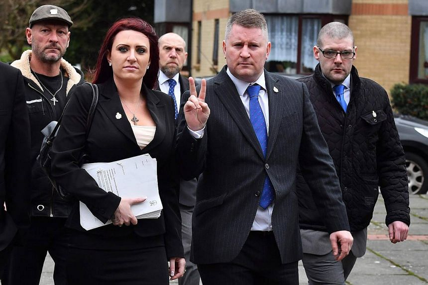 Far-right group Britain First's leader Paul Golding (second from right) and deputy Jayda Fransen arriving at Folkestone magistrates court in Kent on Jan 29, 2018.