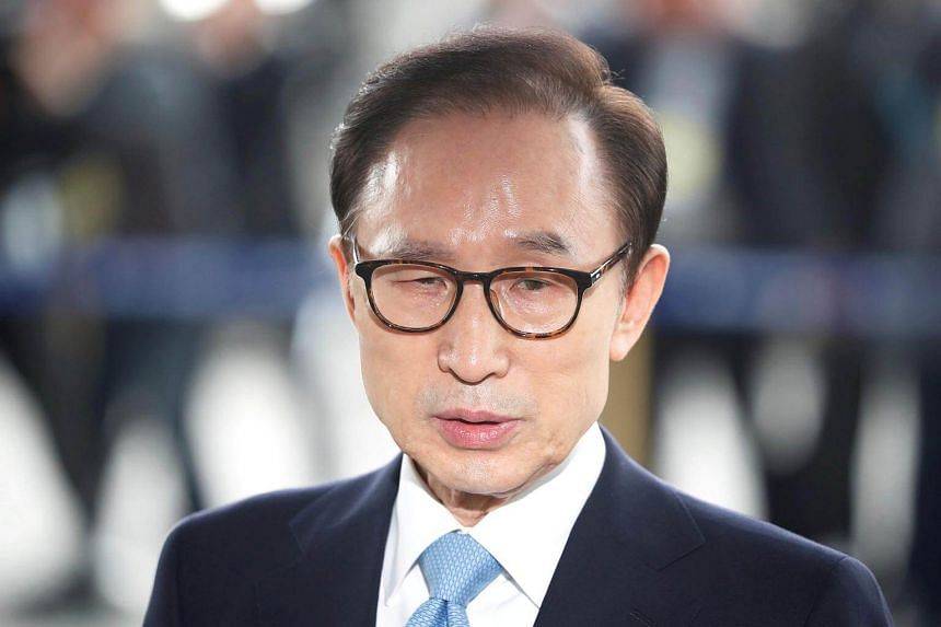 Former South Korean president Lee Myung Bak spent more than 21 hours at the prosecutors' office in Seoul.