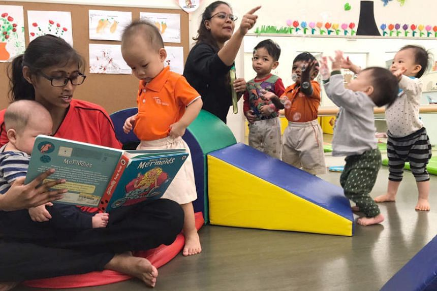 Older toddlers and younger infants learn and play together at My First Skool at Havelock Road as part of a co-sharing pilot model for infants and toddlers.
