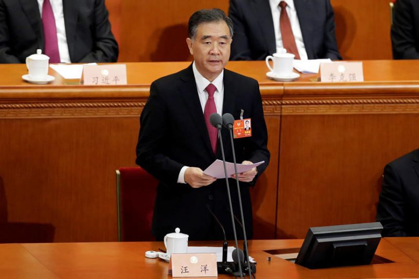 Wang Yang, newly elected chairman of the Chinese People's Political Consultative Conference (CPPCC), speaks during the closing session of the CPPCC at the Great Hall of the People in Beijing, China, on March 15, 2018.