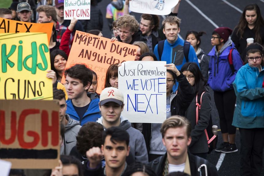 Students from multiple schools gather to protest gun violence in Seattle, March 14, 2018.