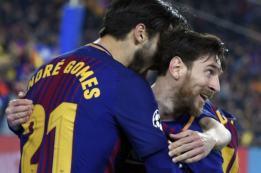 Messi (right) celebrates scoring Barcelona's third goal.